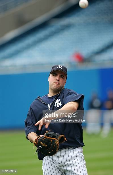 New York Yankees' first baseman Nick Johnson warms up on the field at Yankee Stadium before a game against the Minnesota Twins
