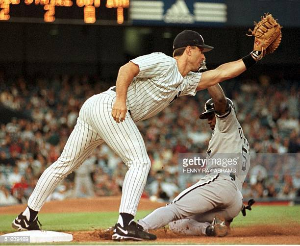 New York Yankees' first baseman Tino Martinez takes the throw from second baseman Chuck Knoblauch to catch the Chicago White Sox Ray Durham off of...