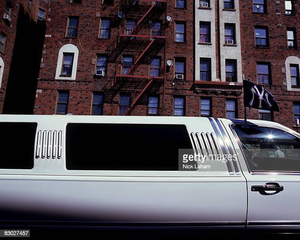 New York Yankees flag waves on a limousine parked in the streets behind Yankee Stadium on September 20 2008 in the Bronx borough of New York City The...