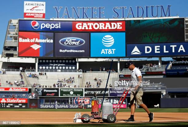New York Yankees grounds crew prepare the field prior to a game against the Toronto Blue Jays at Yankee Stadium on October 1 2017 in the Bronx...