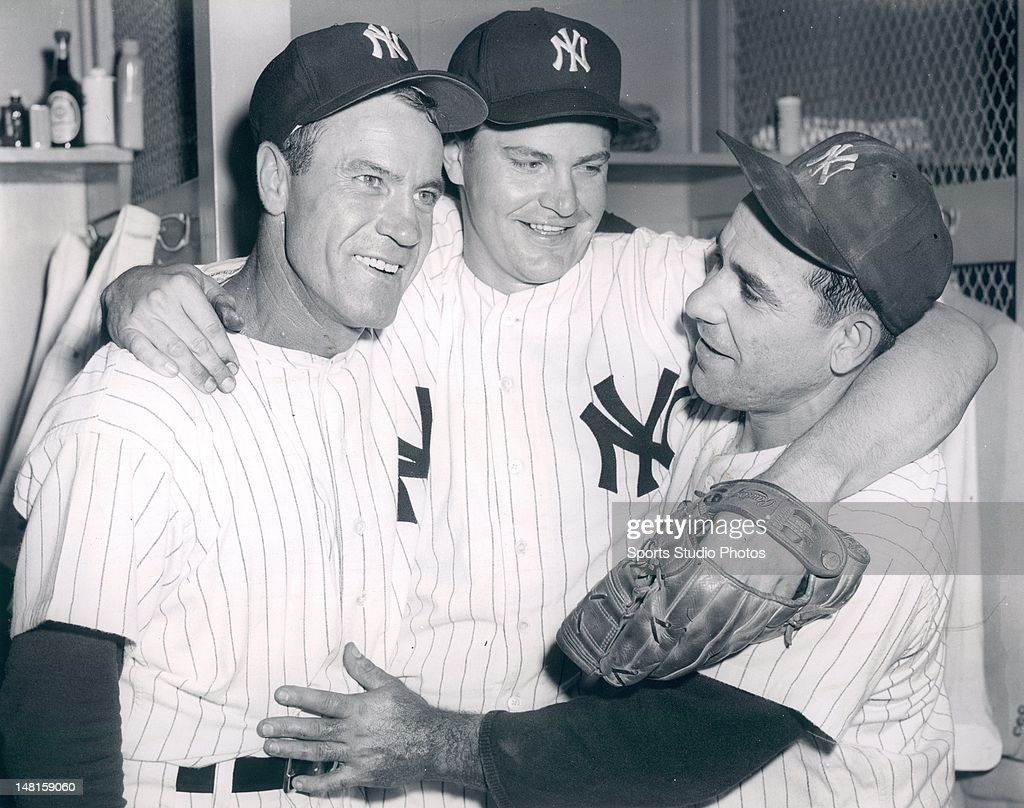 New York Yankees Hank Bauer, Bob Turley and Yogi Berra celebrating after winning the World Series in 1957.