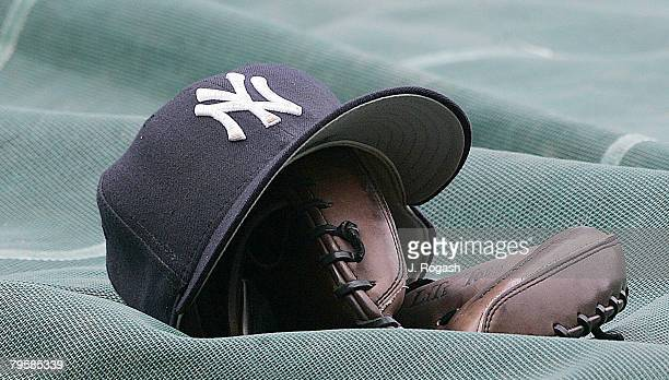 New York Yankees hat and glove rest by the batting cage before a game with the Cleveland Indians at Yankee Stadium in New York Thursday July 7 2005