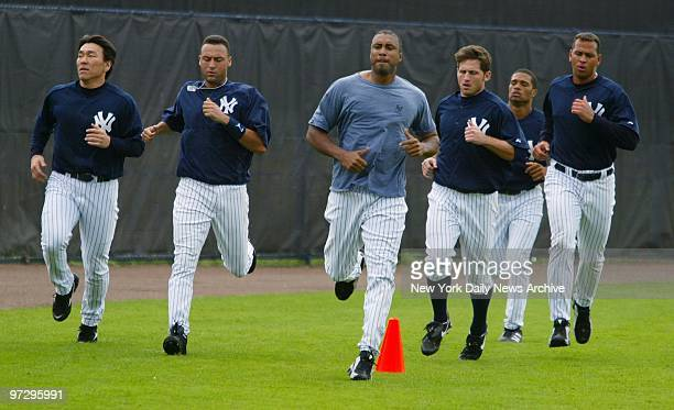 New York Yankees' Hideki Matsui Derek Jeter Bernie Williams Bubba Crosby an unidentified player and Alex Rodriguez jog at the end of a workout at...