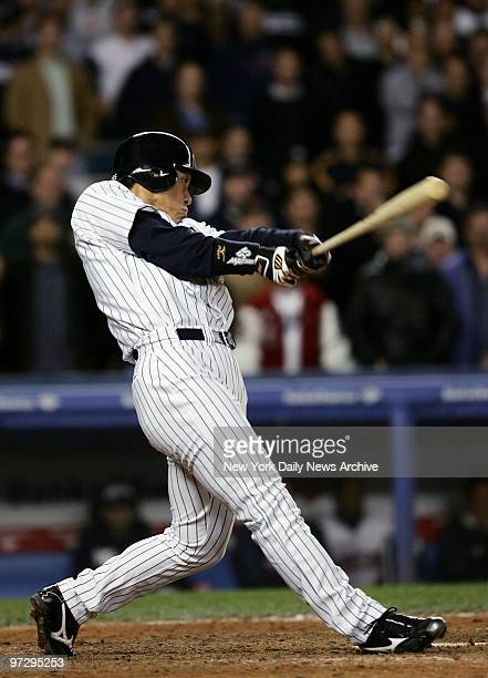 New York Yankees' Hideki Matsui hits a sacrifice fly to right field driving in Derek Jeter for the winning run in the 12th inning of Game 2 of the...