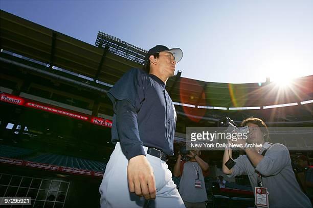 New York Yankees' Hideki Matsui walks on to the field at Angel Stadium to take batting practice before tomorrow's start of the American League...