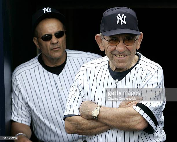 New York Yankees honorary coach Yogi Berra is all smiles on spring training opening day with manager Joe Torre behind him before the start of the...