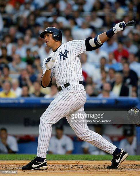 New York Yankees' infielder Alex Rodriguez hits a tworun homer to left field in the first inning of game against the Chicago White Sox at Yankee...