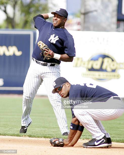 New York Yankees infielder Felix Escalona fields a ball hit up the middle and throws to first for the out in a spring training game against the St...