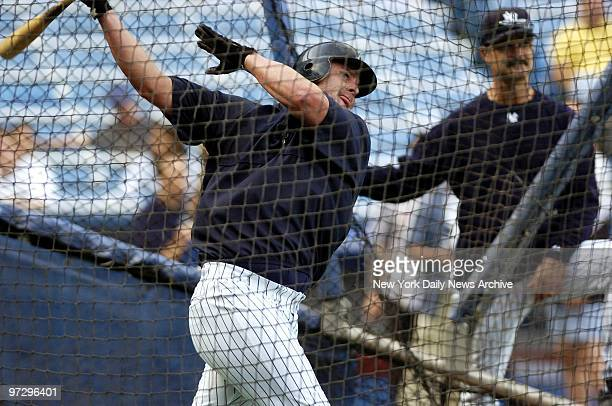 New York Yankees' infielder Jason Giambi takes batting practice as hitting coach Don Mattingly stands by at Yankee Stadium before start of game...