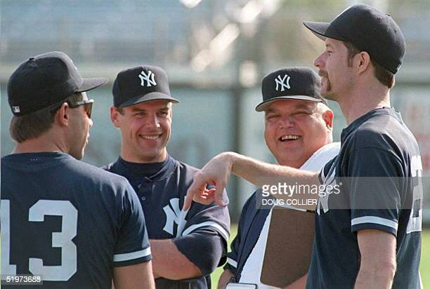 New York Yankees Jack McDowell talks with Coach Billy Connors pitcher John Wetteland and catcher Jim Leyritz during the first official day of Spring...