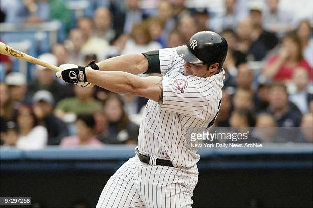 New York Yankees' Jason Giambi hits an RBI single in the first inning against the Tampa Bay Devil Rays at Yankee Stadium. The Yanks went on to win,...