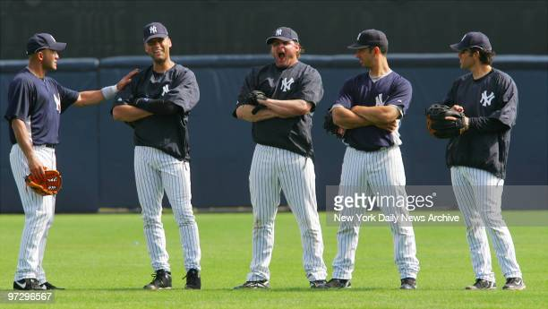 New York Yankees' Jason Giambi lets out a yawn as he and Miguel Cairo Derek Jeter Jorge Posada and Doug Mientkiewicz stand in the field during spring...
