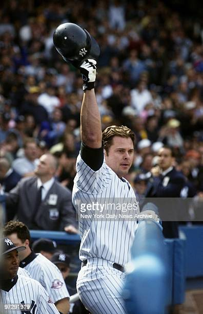 New York Yankees' Jason Giambi tips his hat to the crowd after tying the game in the ninth inning with a threerun homer against the Oakland Athletics...
