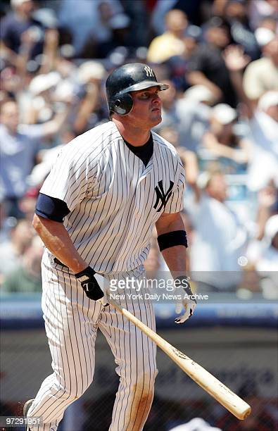 New York Yankees' Jason Giambi watches as the ball heads to the bleachers in rightcenter field for a tworun blast in the fourth inning against the...