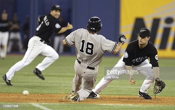 New York Yankees Johnny Damon slides safely into second base with his 300th career stolen base ahead of the tag from Toronto Blue Jay second baseman...