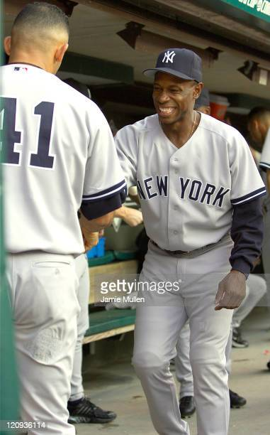 New York Yankees' Kenny Lofton and Miguel Cairo share a light moment prior to their game against the Cleveland Indians Monday August 23 2004 in...