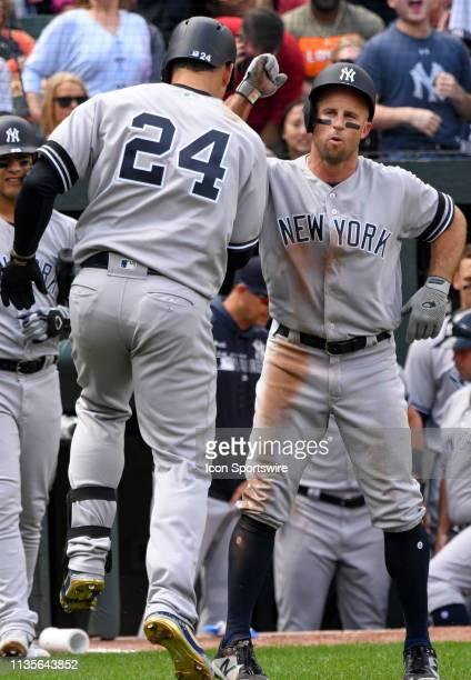 New York Yankees left fielder Brett Gardner congratulates catcher Gary Sanchez after his home run aginst the Baltimore Orioles on April 7 at Orioles...