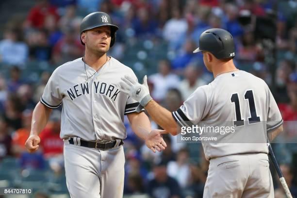 New York Yankees left fielder Brett Gardner slaps hands with designated hitter Matt Holliday during the MLB game between the New York Yankees and...