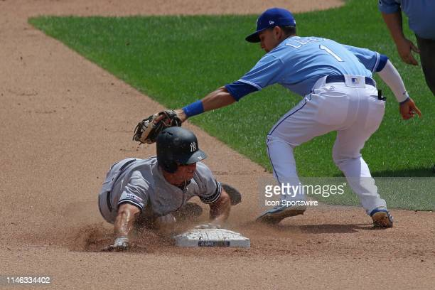 New York Yankees left fielder Brett Gardner slides into second to beat the throw for a stolen base in the fourth inning of an MLB game between the...