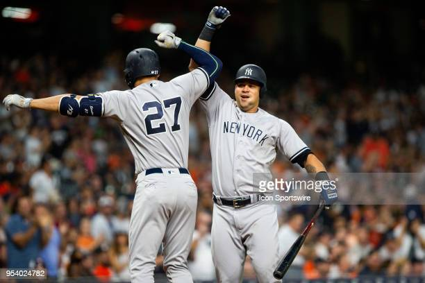 New York Yankees left fielder Giancarlo Stanton celebrates with New York Yankees catcher Gary Sanchez after hitting a second homer in the fourth...