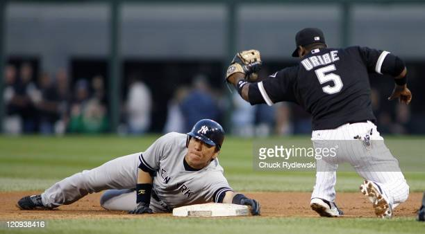 New York Yankees' Left Fielder Hideki Matsui evades Juan Uribe's tag and slides safely into 2nd base during their game versus the Chicago White Sox...