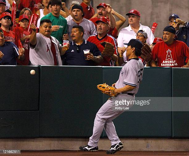 New York Yankees left fielder Hideki Matsui watches a home run by Bengie Molina of the Los Angeles Angels of Anaheim clear the outfield fence during...