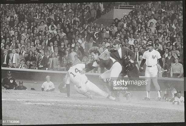 New York Yankees' Lou Piniella collides with Red Sox catcher Carlton Fisk, as Carl Yastrzemski and Sandy Alomar try to separate them.