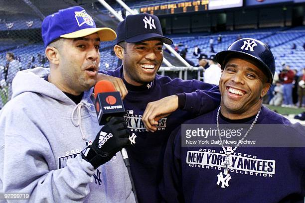 New York Yankees' Luis Sojo Mariano Rivera and Luis Polonia tape a spot for Venezuelan TV before the start of Game 2 of the World Series against the...