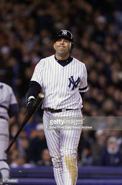 New York Yankees' Luis Sojo wears an unhappy look back to the dugout after striking out to end the seventh inning during Game 1 of the American...