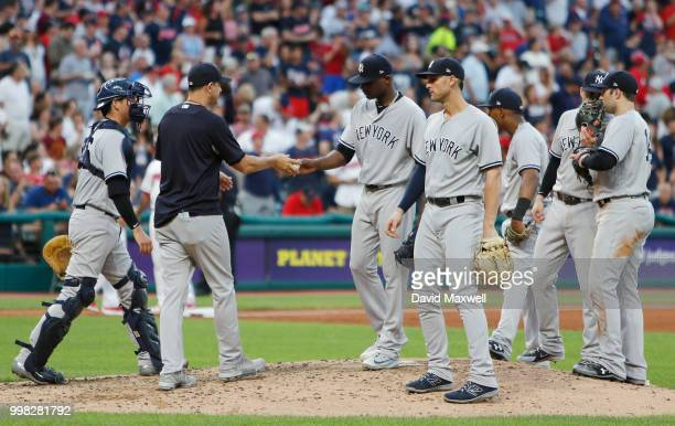 New York Yankees Manager Aaron Boone removes starting pitcher Domingo German from the game during the fifth inning against the Cleveland Indians at...