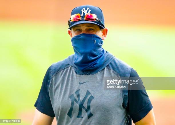 New York Yankees manager Aaron Boone returns to the dugout in the sixth inning of game one of the MLB doubleheader against the Atlanta Braves at...