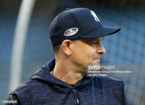 New York Yankees manager Aaron Boone watches during batting practice before the American League wild-card game against the Oakland Athletics in the...