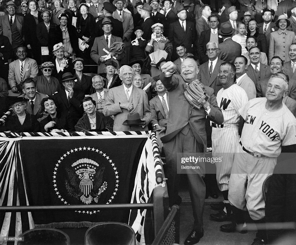 New York Yankees' manager Casey Stengel (right) and Washington Senators' pilot Bucky Harris, always on the lookout for new talent, watch President Eisenhower throw out the first ball to officially open the 1954 baseball season, April 13th. At left are Mrs. Eisenhower and (standing next to her) Clark Griffith, owner of the Senators. Washington beat the Yanks, 5-3, in 10 innings.