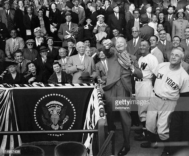 New York Yankees' manager Casey Stengel and Washington Senators' pilot Bucky Harris always on the lookout for new talent watch President Eisenhower...