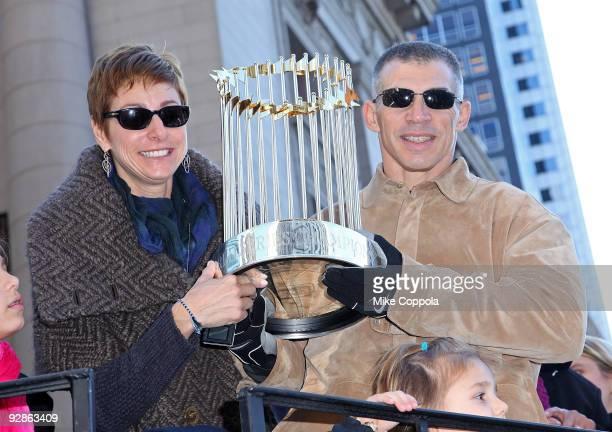 New York Yankees Manager Joe Girardi and wife Kimberly Girardi hold up the World Series Trophy at the 2009 New York Yankees World Series Victory...