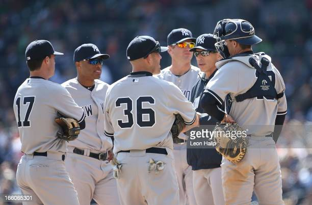 New York Yankees manager Joe Girardi talks with Jayson Nix Robinson Cano Kevin Youkillis Lyle Overbay and Chris Stewart during the game against the...