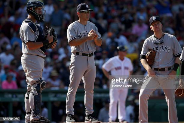 New York Yankees manager Joe Girardi waits on the mound for a new pitcher after a RBI single by Boston Red Sox center fielder Jackie Bradley Jr in...