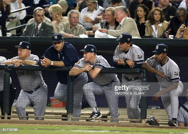 New York Yankees Manager Joe Torre and Yankee coaches Don Zimmer Mel Stottlemyre Lee Mazzelli and Willie Randolph watch the play from the dugout in...