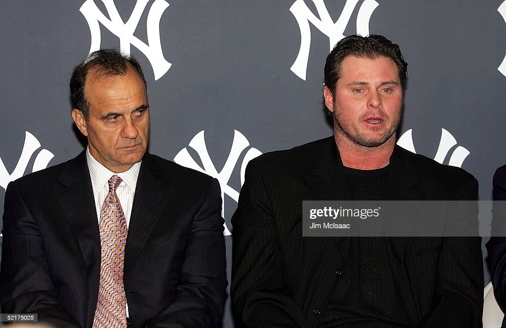 New York Yankees manager Joe Torre listens to his player Jason Giambi speak during his press conference to discuss his alleged steroid use on February 10, 2005 at Yankee Stadium in Bronx borough of New York City.