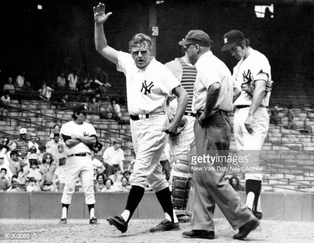 New York Yankees' manager Ralph Houk vents his frustration over a call with first base umpire Marty Springstead during a game against the Kansas City...
