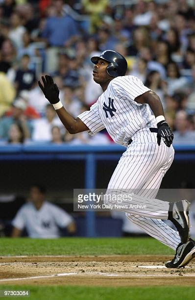 New York Yankees' Marcus Thames hits a tworun homer in his first atbat in the third inning of game against the Arizona Diamondbacks at Yankee Stadium...
