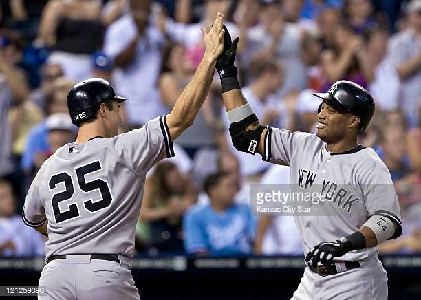 New York Yankees' Mark Teixeira congratulates Robinson Cano at the plate after Cano's threerun home run in the fourth inning during against the...