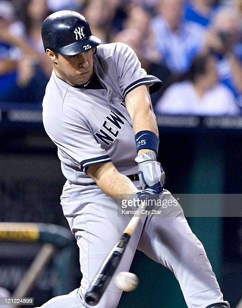 New York Yankees' Mark Teixeira connects on an RBI double in the 8th inning to score Derek Jeter during Monday's baseball game against the Kansas...