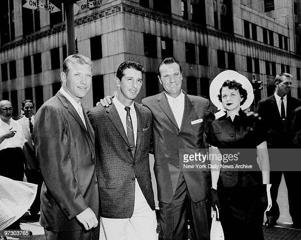 New York Yankees Mickey Mantle Billy Martin Hank Bauer and Bauer's wife Charlene leaving the district attorney's office after a grand jury declined...