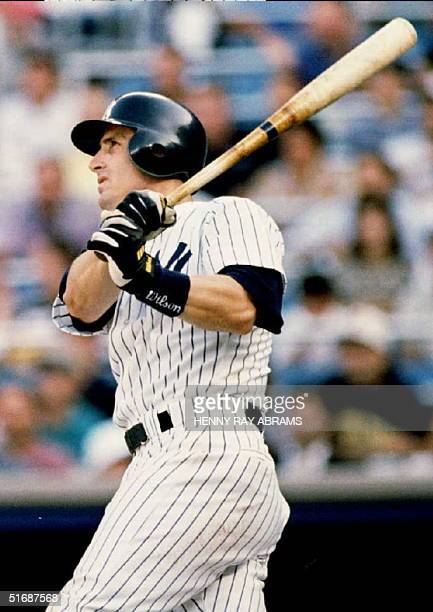 New York Yankees' Mike Stanley hit three home runs, including this sixth inning grand slam over the center field wall, and drove in seven runs in the...