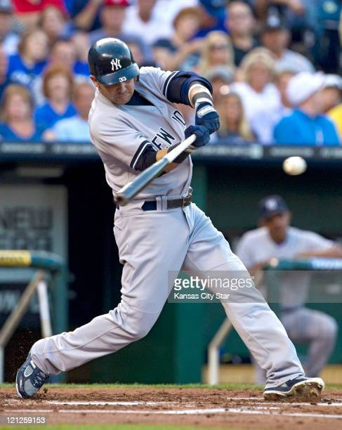 New York Yankees' Nick Swisher connects on a single in the second inning against the Kansas City Royals at Kauffman Stadium in Kansas City Missouri...