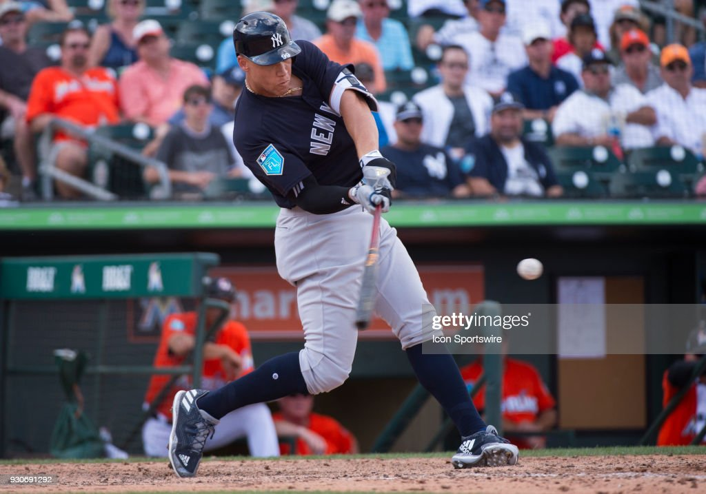New York Yankees Outfielder Aaron Judge (99) bats, hitting a home run during an MLB spring training game between the New York Yankees and the Miami Marlins at Roger Dean Stadium in Jupiter, Florida on March 11, 2018.