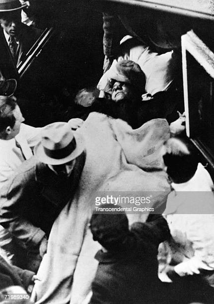 New York Yankees outfielder Babe Ruth is loaded into an ambulance near Penn Station in New York after suffering an internal pain which was dubbed...