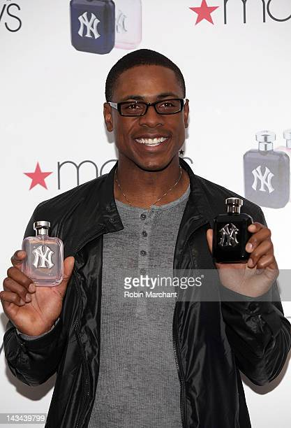 New York Yankees outfielder Curtis Granderson attends the New York Yankees fragrance launch at Macy's Herald Square on April 26 2012 in New York City