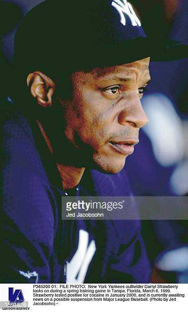 New York Yankees outfielder Darryl Strawberry looks on during a spring training game in Tampa Florida March 6 1999 Strawberry tested positive for...